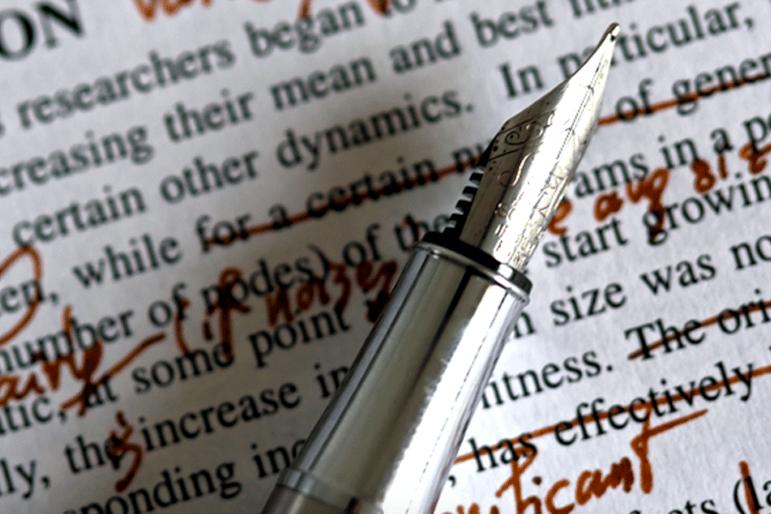 A stylograph lying on a manuscript