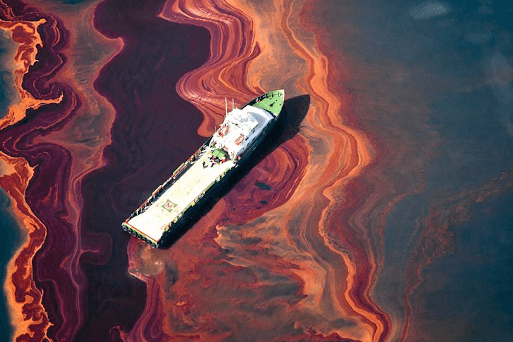 Oil spill in the ocean caused by a ship